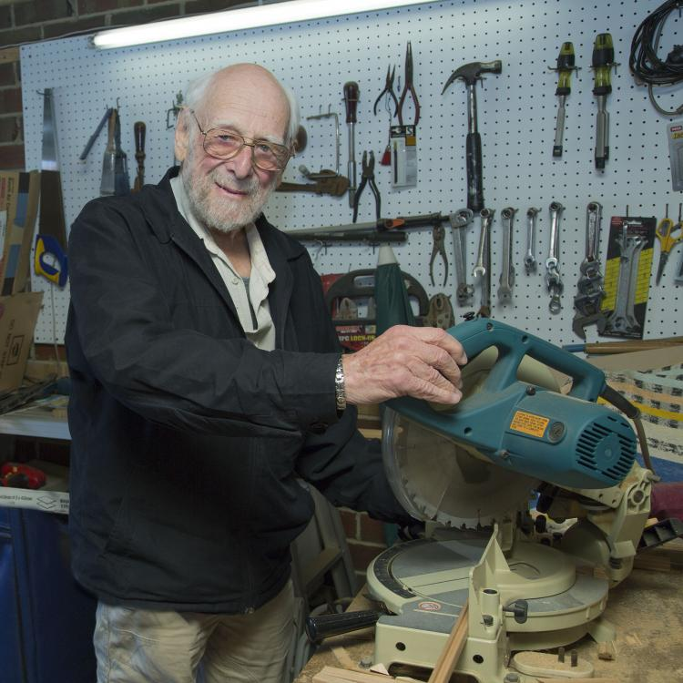man in workshop with tools